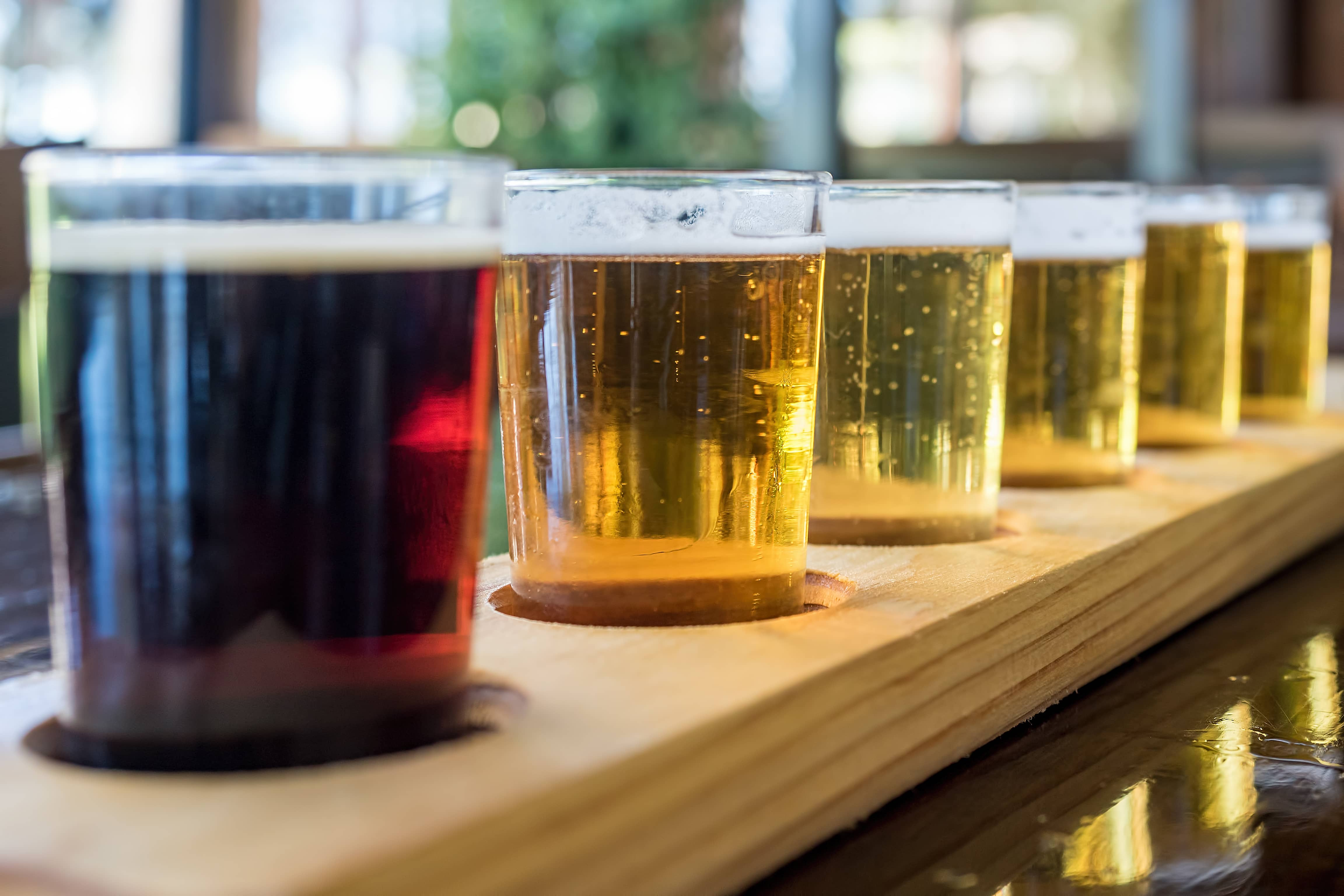 Beer samplers in unique wooden tray